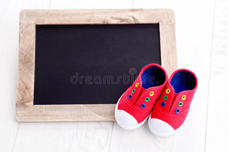 Frame and baby shoes royalty free stock photography