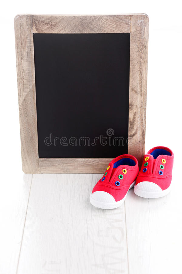 Frame and baby shoes stock photography