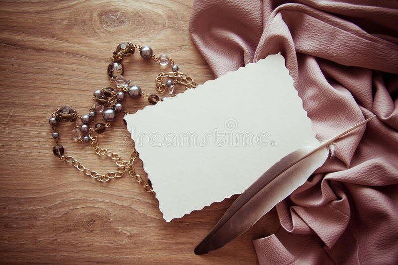 Frame background with silk drapery and vintage postcard. Backgrund with black pearls and postcard for text royalty free stock photos