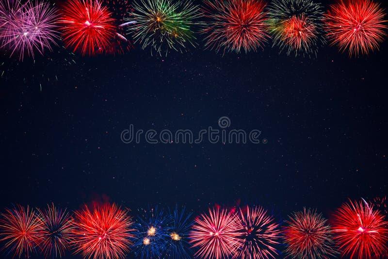 Frame of beautiful celebration golden, red, purple, green sparkling fireworks royalty free stock image