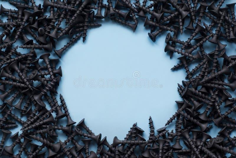 Frame of black screws stock photo