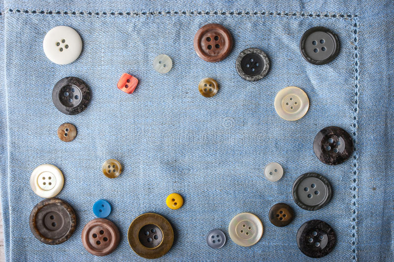 Frame of the buttons on the blue cloth. Top view royalty free stock image