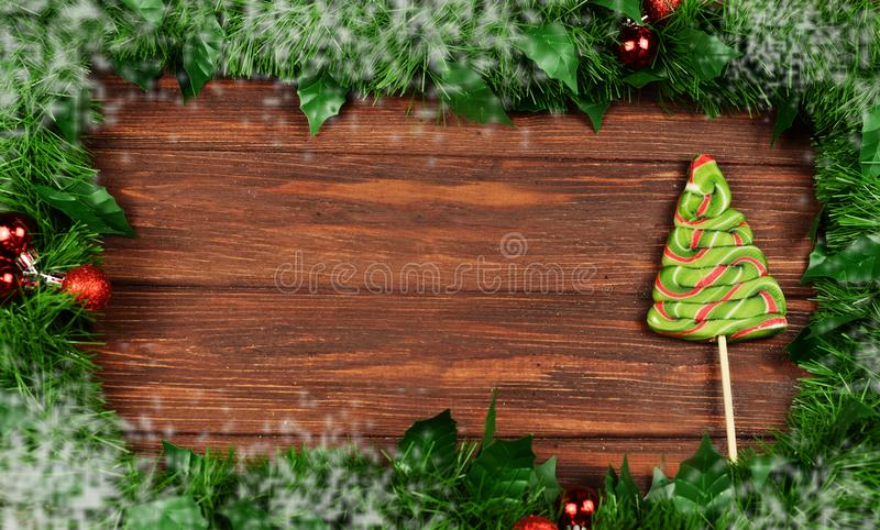 frame of Christmas tree branches with toys on a wooden background royalty free stock photography