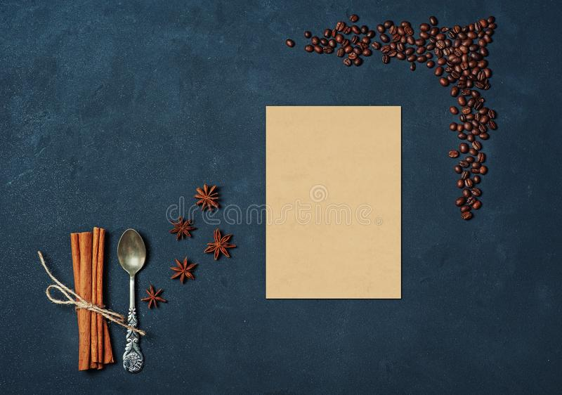 Frame of Coffee Beans Cinnamon sticks Spoon and anise stars on Dark Texture Table decorated with empty card. Kitchen Ingredients stock photo