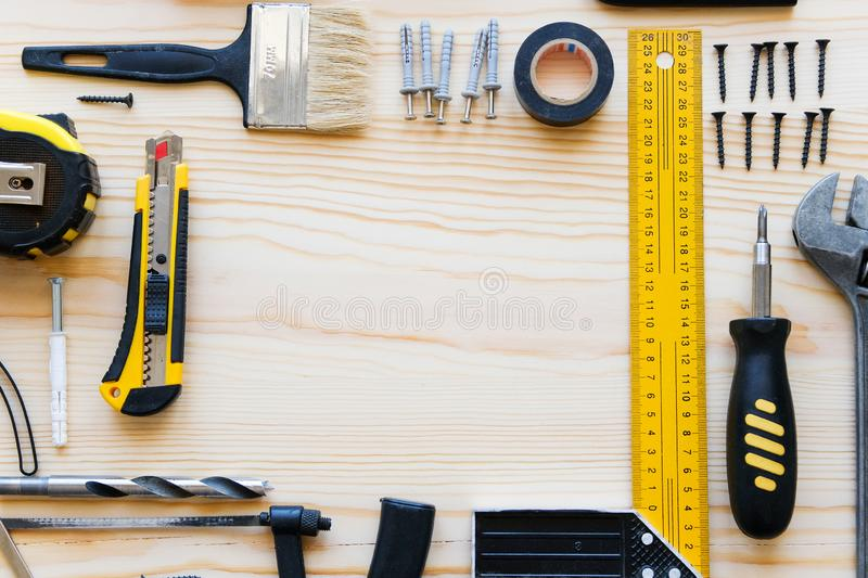 Frame or composition of construction tools for building a house or apartment renovation, on a wooden table. The workplace of the stock photo