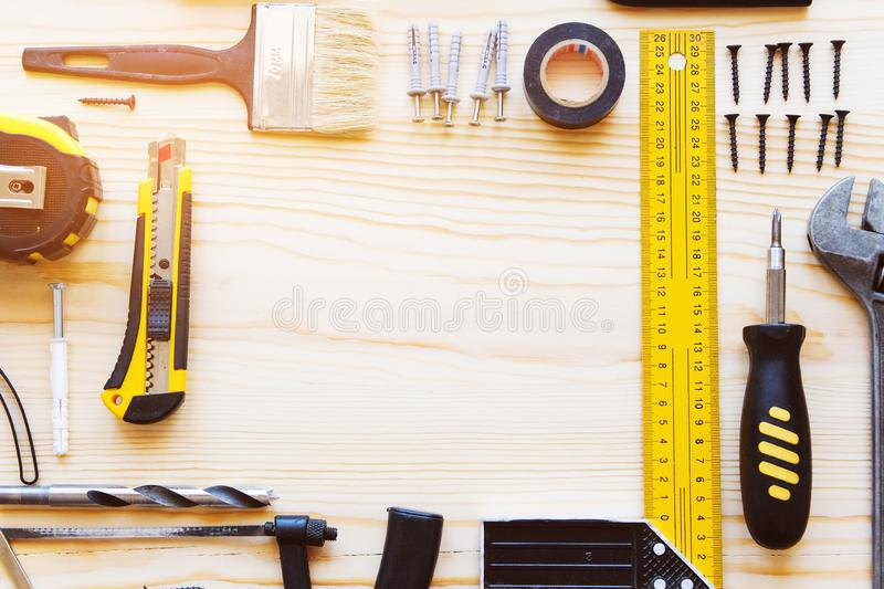 Frame or composition of construction tools for building a house or apartment renovation, on a wooden table. The workplace of the royalty free stock photography