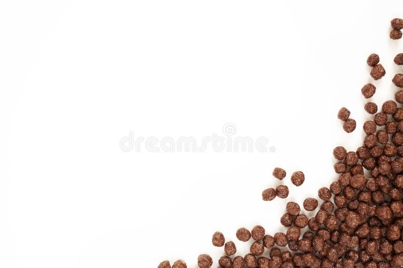 Frame Corn Flakes Chocolate Balls Isolated Top View on White Background royalty free stock images