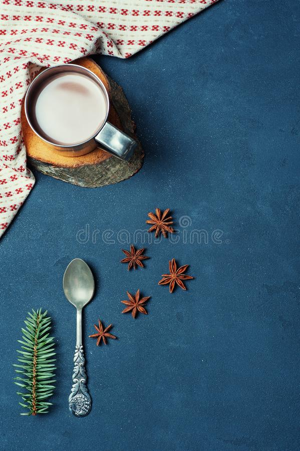 Frame of Cup of Cacao Coffee Beans Cinnamon sticks Spoon and Fir Branch on Dark Texture Table decorated Napkin. Kitchen Ingredient stock photos