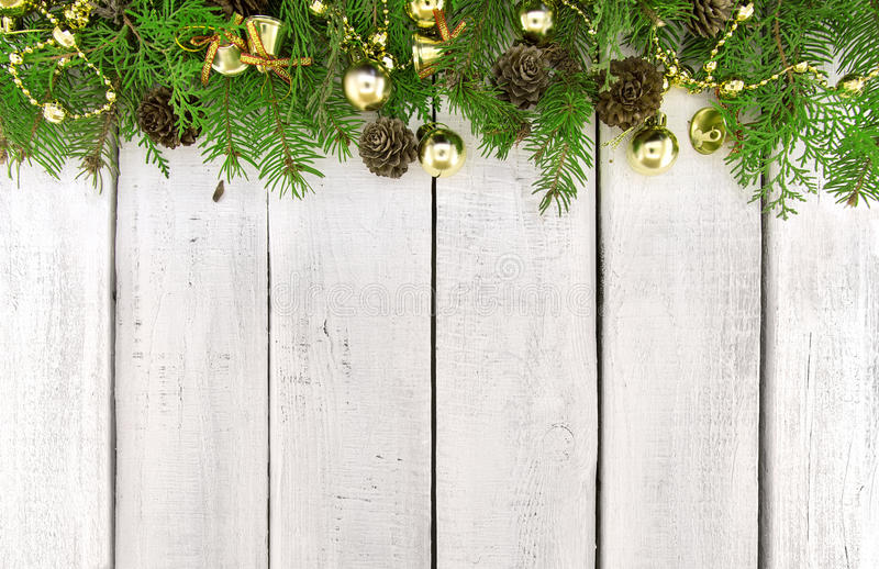 Frame from decorated Christmas tree on white rustic wooden background with copy space for text. Happy New Year concept. Holiday b stock photography