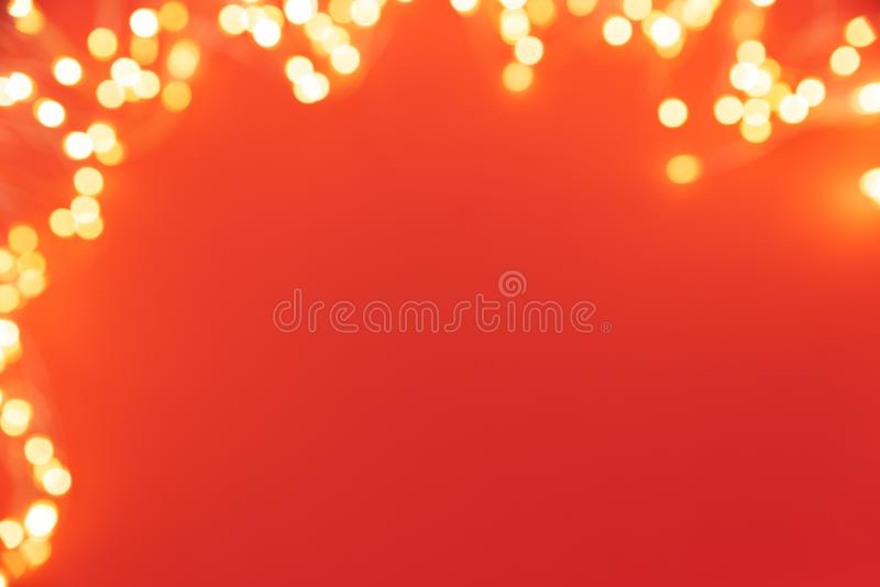Frame of defocused Christmas lights on red background. Christmas and New Year holidays celebration concept stock photography