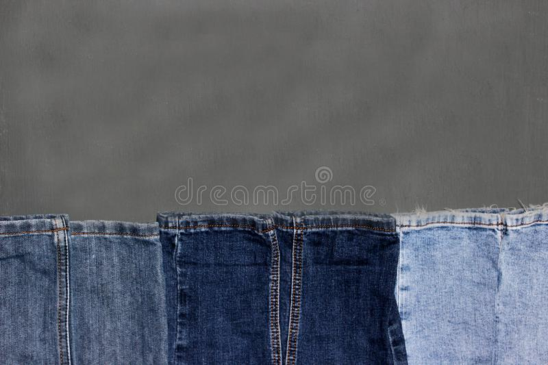 Frame denim on a grey background royalty free stock images