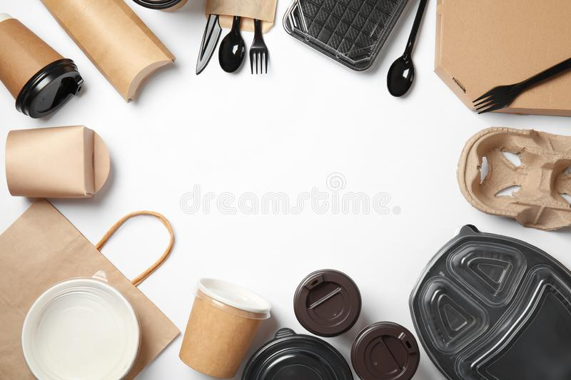 Frame of different takeout containers and space for text on white background, top view. Food delivery service stock photography