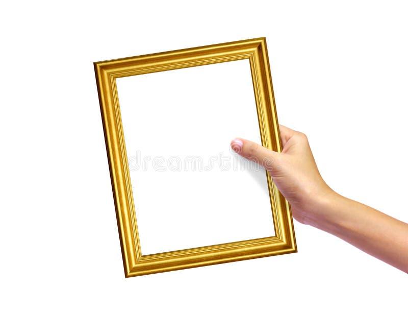 Frame do ouro na mão da mulher fotografia de stock royalty free