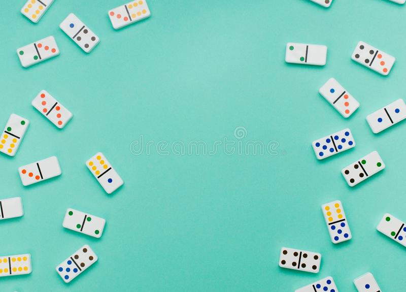Frame of dominoes on mint green background stock image