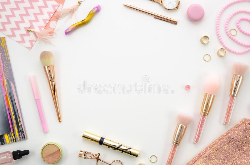 Flat lay frame mockup composition with cosmetics, makeup tools, on white background pink colors. beauty, fashion, party stock images