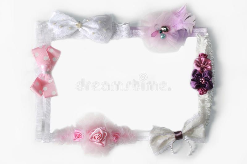 Frame of flowers and bows. Frame of pink, lilac and purple flowers and bows stock photography