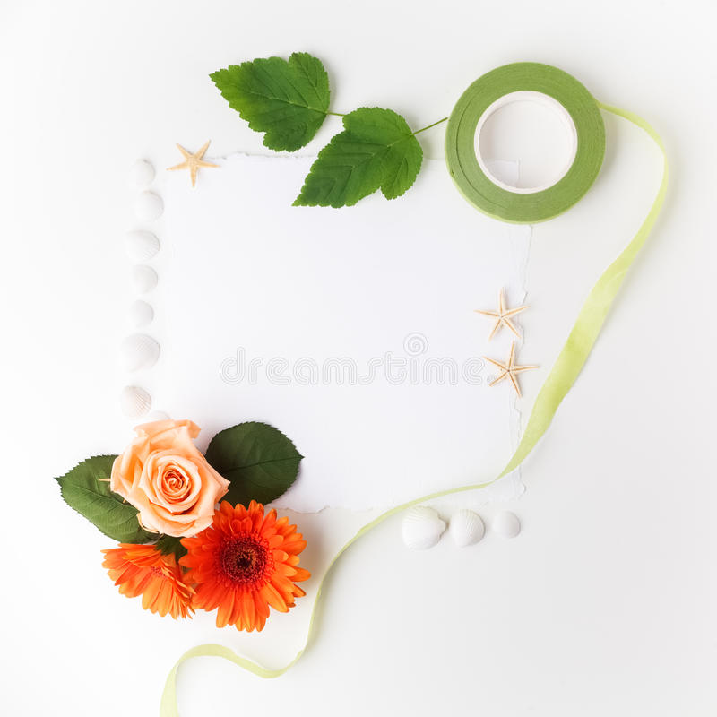 Frame of flowers on a white table ,with space for text, summer theme. Top view. Flat lay. Frame of flowers on a white table ,with space for text, summer theme royalty free stock photo