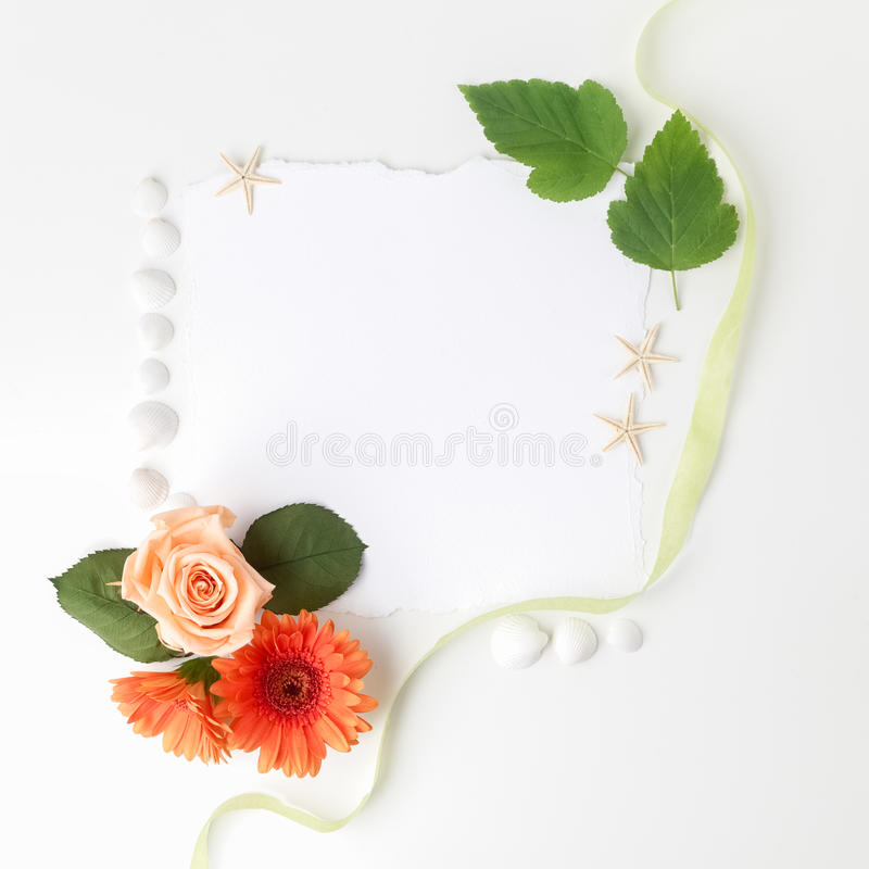 Frame of flowers on a white table ,with space for text, summer theme. Top view. Flat lay. Frame of flowers on a white table ,with space for text, summer theme stock image