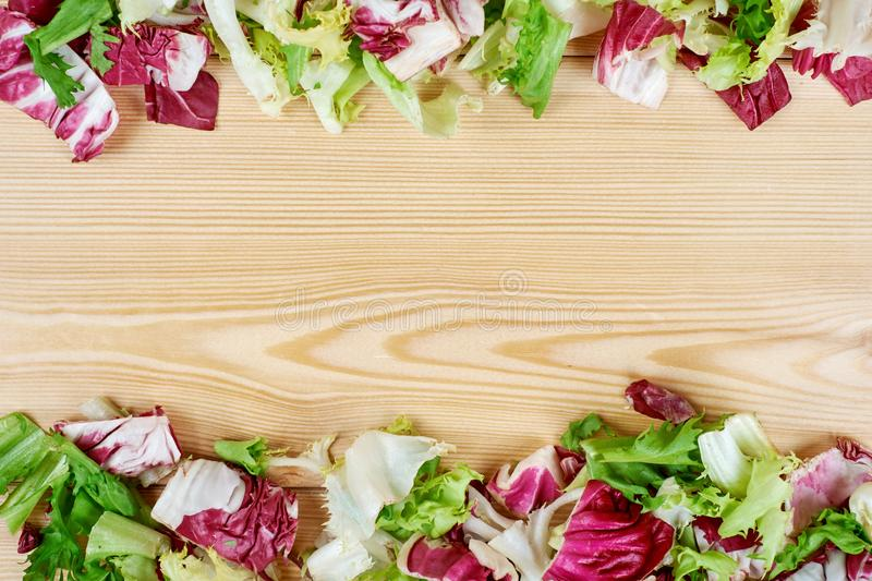 Frame Of Fresh Green Salad On Wooden Background. Healthy Natural ...