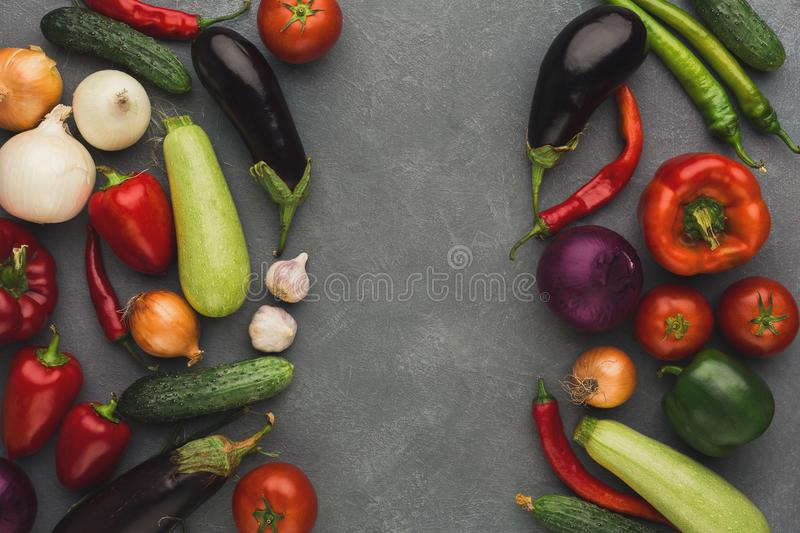 Frame of fresh vegetables on grey backgroundwith copy space. Frame of fresh organic vegetables on grey background. Healthy natural food on rustic wooden table stock image