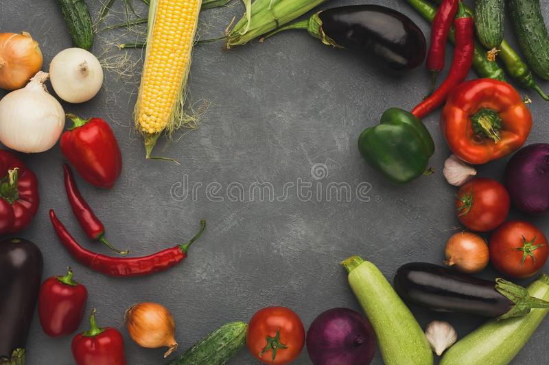 Frame of fresh vegetables on grey backgroundwith copy space. Frame of fresh organic vegetables on grey background. Healthy natural food on rustic wooden table stock photography