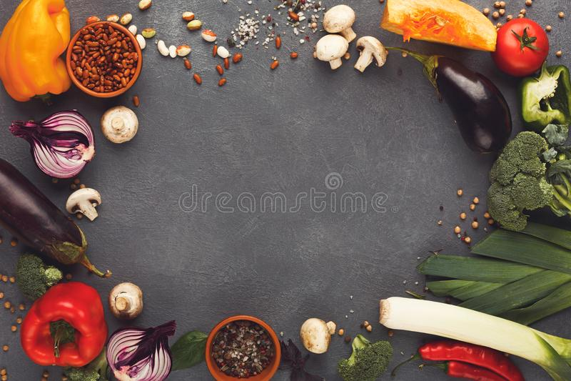 Frame of fresh vegetables on wooden background with copy space. Frame of fresh organic vegetables on gray background. Healthy natural food on rustic wooden table stock photo