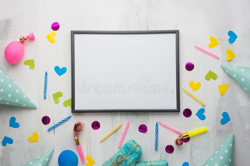 A frame with gifts, hats for birthday parties, and congratulations. With an empty space for the inscription. Confetti happy party fun celebration design holiday royalty free stock photography