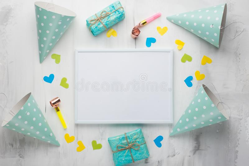 A frame with gifts, hats for birthday parties, and congratulations. With an empty space for the inscription. Confetti happy party fun celebration design holiday royalty free stock image