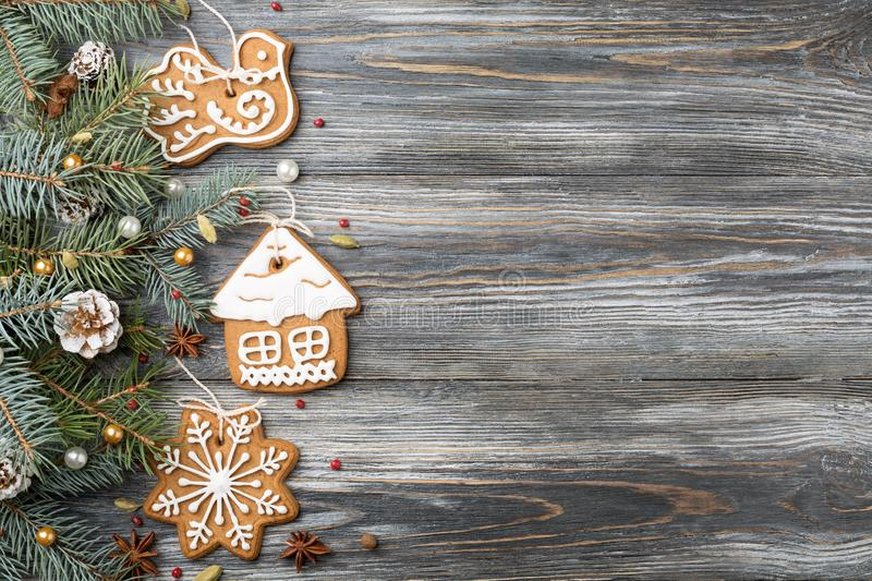 Frame of Gingerbread cookies & Christmas decorations on spruce o royalty free stock image