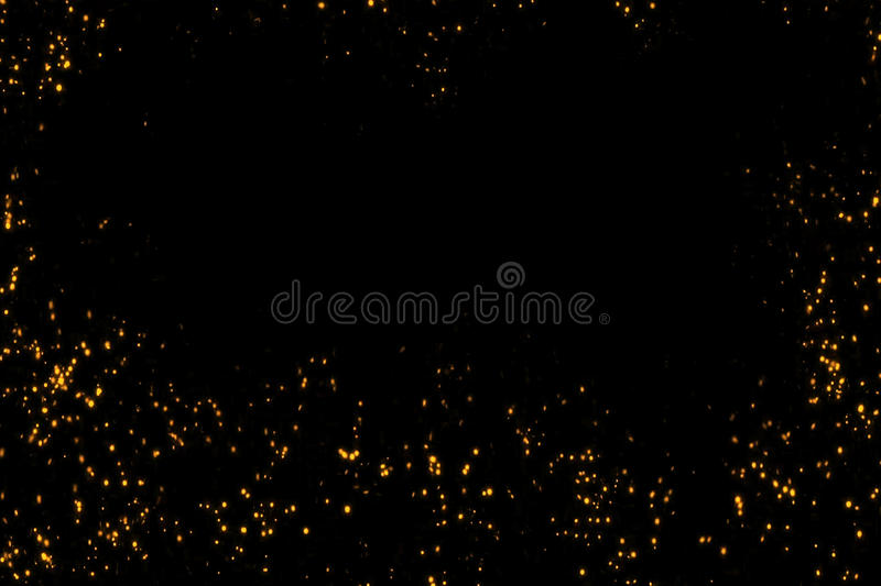 Frame of golden glitter sparkle bubbles particles stars on black background, event festive happy new year holiday stock image