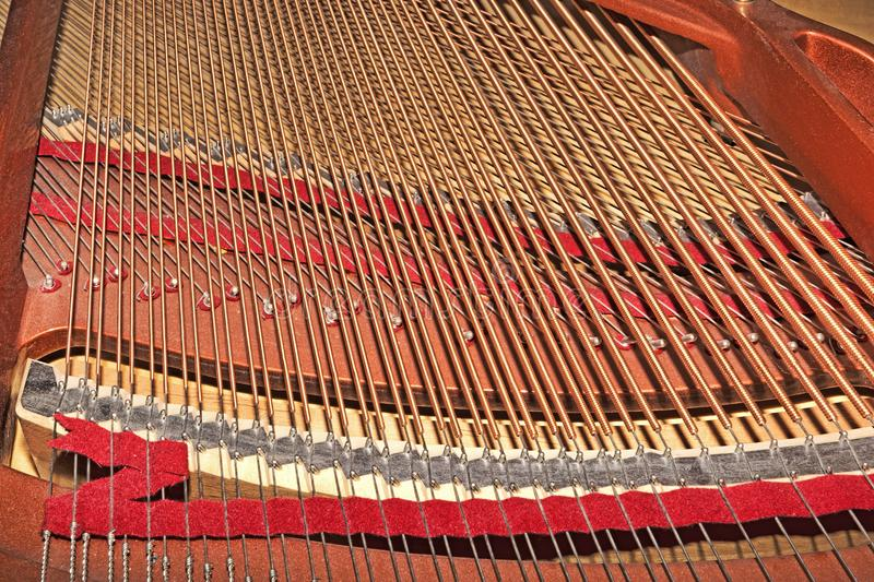 Frame of a grand piano - selective focus. Frame of a grand piano in selective focus stock photos