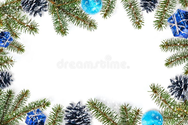 Blue Christmas bauble, tree branches on white wooden texture ready for your design. Marry Christmas, winter, concept of the New Ye royalty free stock image
