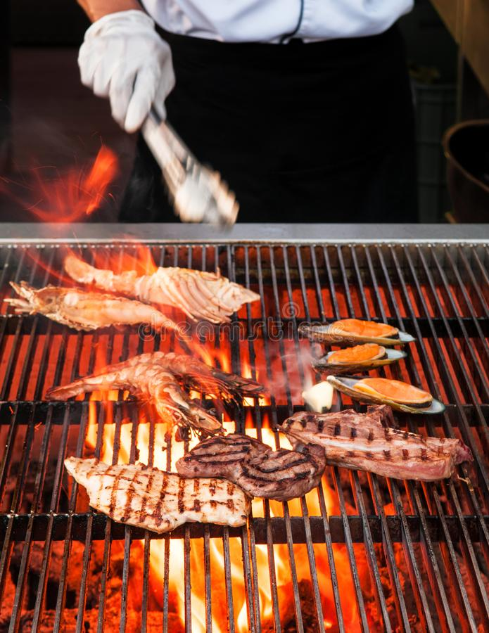 Frame grilled seafood barbecue, grilling seafood on frame. Frame grilled seafood barbeque, grilling seafood on frame, surf & turf barbecue stock photo