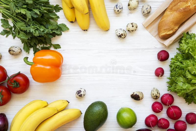 Frame of health food on a white wooden background. Healthy eating. Top view. From above. Flat lay. Copy space royalty free stock image