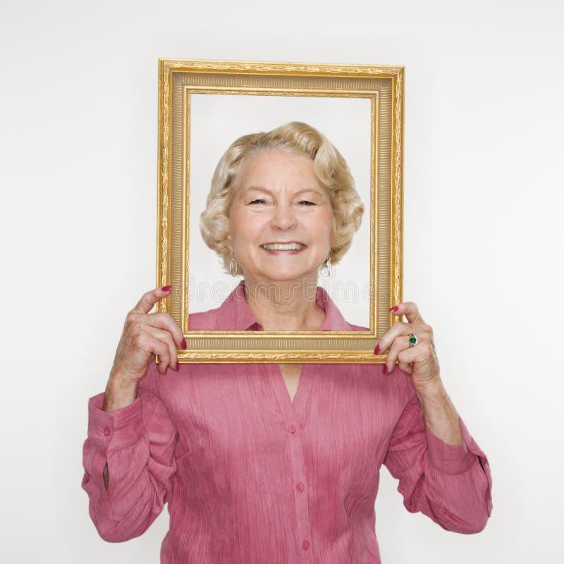 frame holding picture woman στοκ φωτογραφία με δικαίωμα ελεύθερης χρήσης