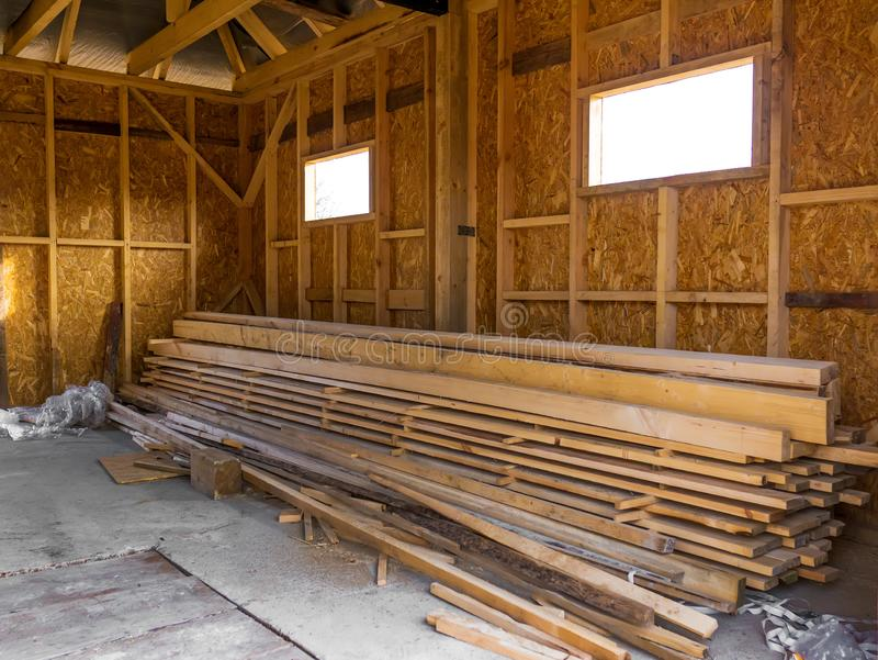 Frame house made of timber. Lumber in the pile.  royalty free stock photography