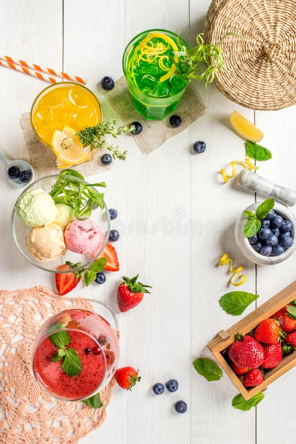 Frame of ice cream cocktails and berries. Shot from above with space for inscription stock photography
