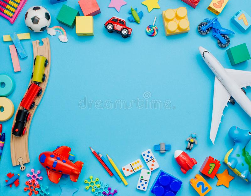 Frame of kids toys on blue background stock image