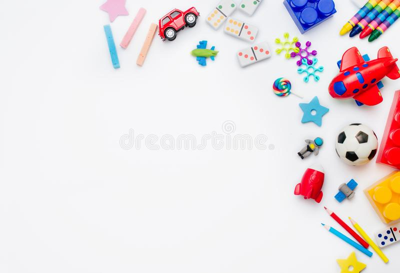 Frame of kids toys on white background with copy space royalty free stock photo