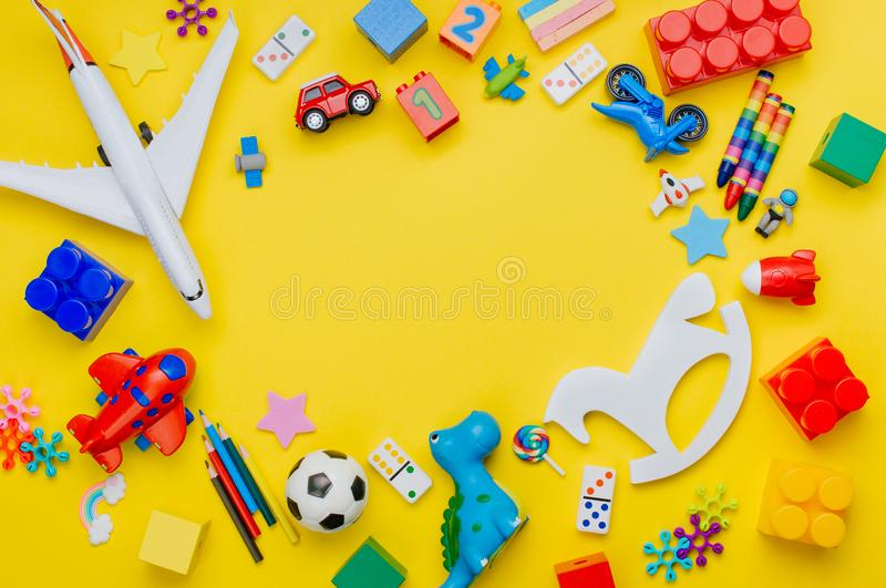 Frame of kids toys on yellow background stock photo