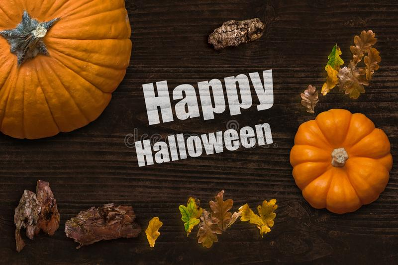 Frame of leaves and pumpkins and the message `Happy Halloween` royalty free stock photo