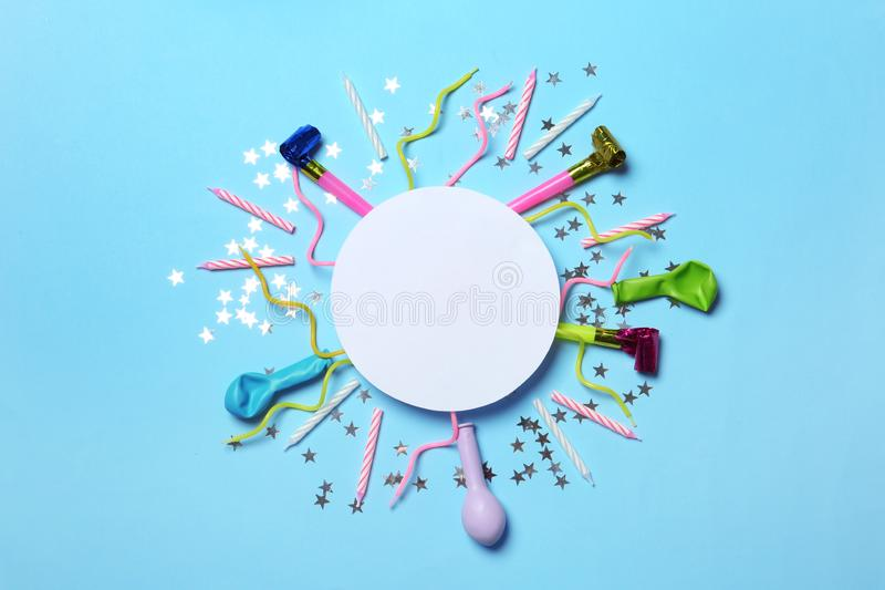 Frame made of balloons and party accessories on color background, top view stock photo
