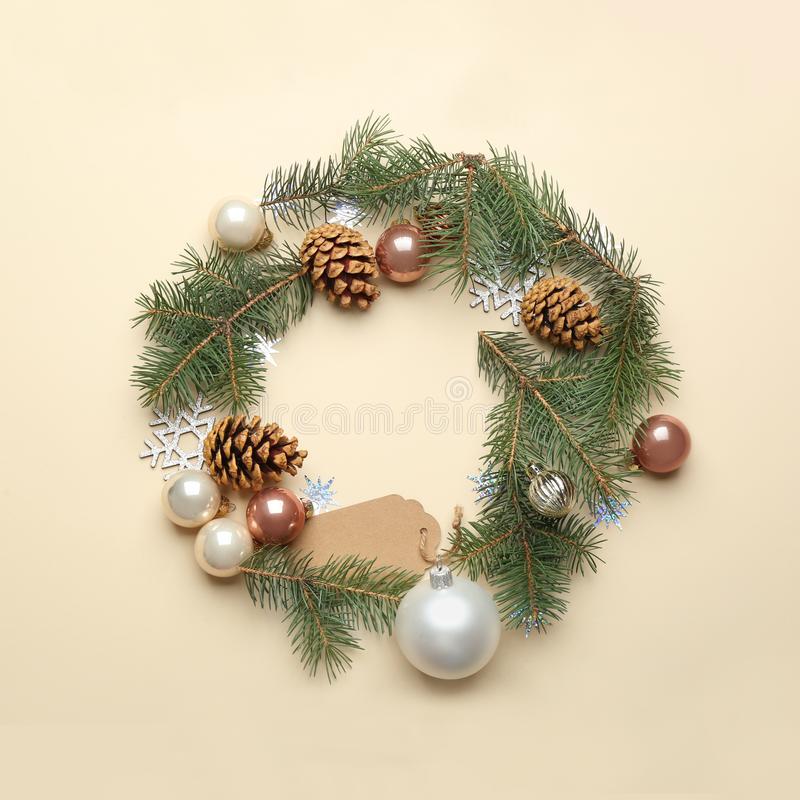 Frame made of Christmas  on beige background, top view with space for text. Winter season. Frame made of Christmas decorations on beige background, top view with royalty free stock photo