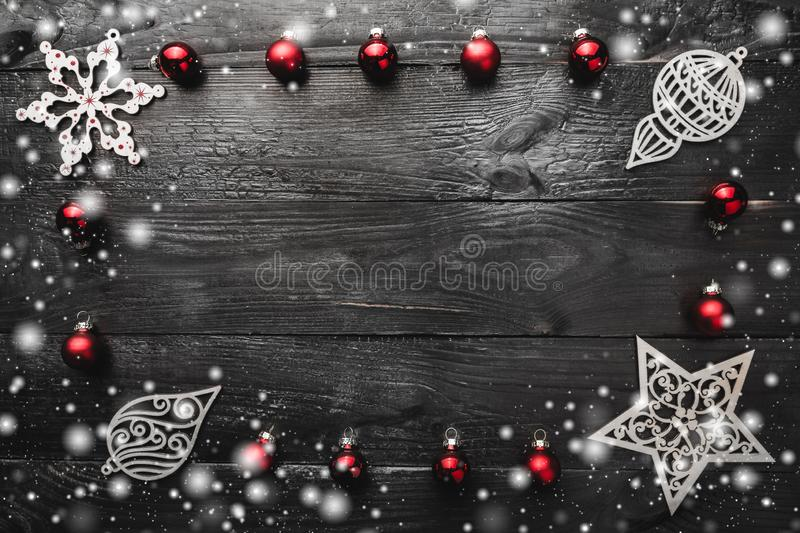 Frame made of christmas decoration, xmas balls, ornamented wooden toys and snowflakes. Flat lay, top view stock photo