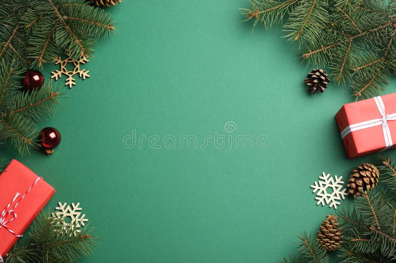 Frame made of Christmas decorations on green background, space for text. Winter season royalty free stock photos