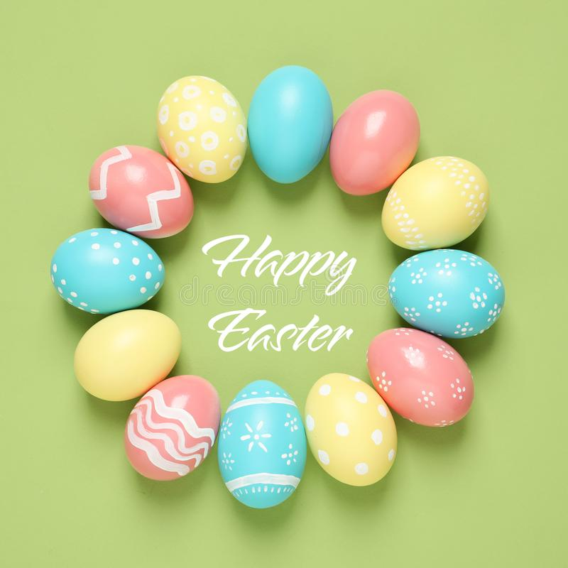 Frame made of colorful painted eggs and text Happy Easter on color background stock image