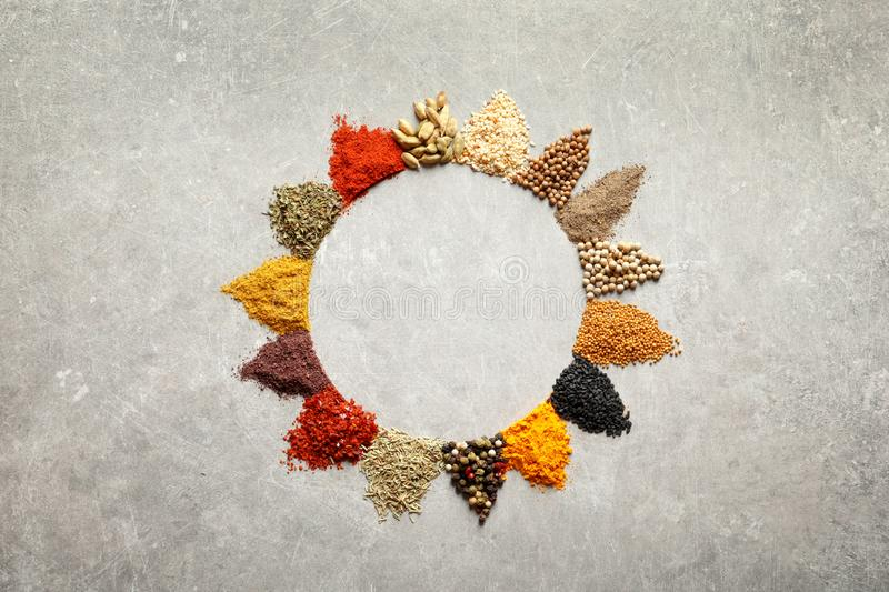 Frame made of different aromatic spices on light background, top view. With space for text royalty free stock photos