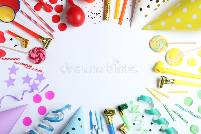 Frame made of different birthday party items on white background, top view. Space for. Text stock photography