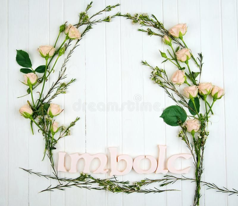 A frame made of flowers and Imbolc word royalty free stock image
