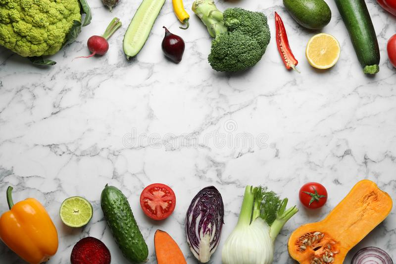 Frame made of fresh ripe vegetables and fruits on marble background, flat lay. royalty free stock images